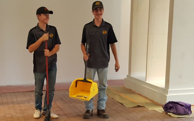 Employees working as general labor cleaning a building
